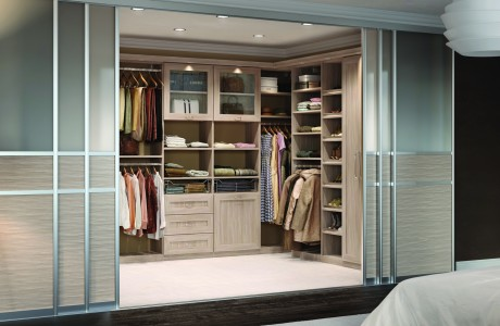 Light Wood Walk in Closet with Shelving Display and Closet Cabinets Closet Rods Built in Lighitng and Frosted Glass and Metal Sliding Doors
