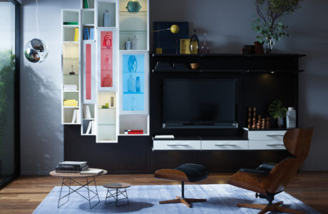 Black Entertainment Center With White Drawers and Lighted Tower Display Shelving with Red and Blue Glass Doors