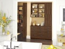 Dark Wood Built in Storage and Library Shelving with Drawers and Cabinets
