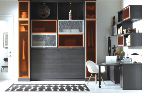 Grey Themed Office Space with Shelving Desk Murphy Bed and Translucent Orange Accent Cabinets