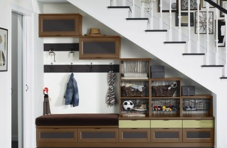 Dark Brown Tiered Storage with Cubbies Cabinets Metal Baskets Coat Hooks and Built in Seating