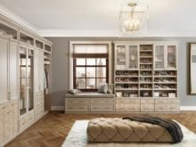 Beige Walk in Closet with Display Cabinets Shelving Closet Rods and Built in Seating