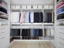 All White Walk in CLoset with Shelving Closet Rods Basket Storage and Cabinets