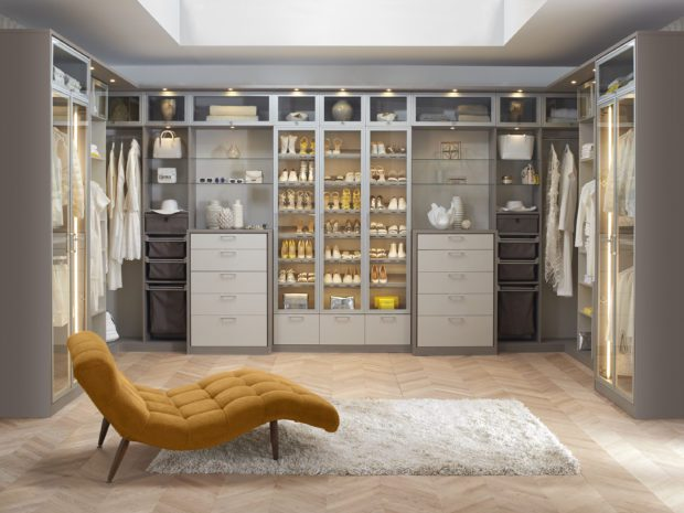 Light Grey Walk in Closet with Shelving Closet Rods Built in Lighting and White Accents