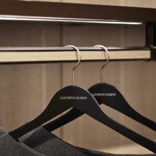 Close Up Image of Light Wood and Grey metal Closet Rods