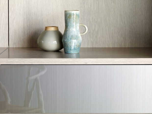 Close Up of Light Grey Shelf with Metalic Grey Fronted Drawer