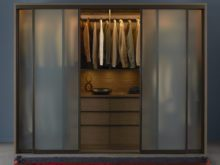 Stand Alone Dark Brown Wardrobe with Dresser Closet Rods and Frosted Glass and Metal Sliding Doors