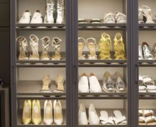 CLose Up Image of LIghted Shoe Racks with Glass Display Doors