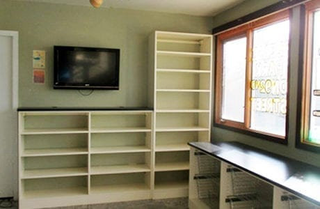 Built in Storage with White Shelving Metal Slide Out Baskets and Black Counter Tops