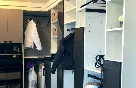 White Walk in Closet with Shelving Closet Rods and Grey and Black Cabinet Doors