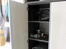 Kapala Family Client Story Adriatic Mist Finish Storage Cabinets with Brushed Stainless Hardware