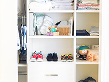 Client Story The Style Editrix Nursery White Closet with Baby Shoe Storage and Large Pull Out Drawers