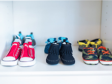 Client Story The Style Editrix Nursery Close Up of Shoes Sitting on White Parcel Shelf