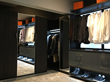 Lighting Contest Client Story Dark Brown Walk In Closet with Added Accent Lighting Along Top