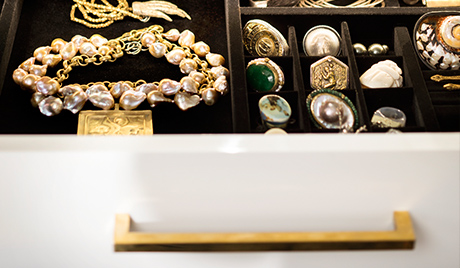 Susan Ferrier Client Story Close Up of White Jewelry Drawer with Brass Handles
