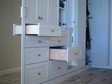 White drawers pulled out from wall cabinetry