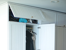 White overhead pull out shelving and cabinet doors