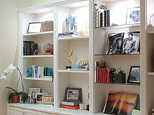 White shelving displaying pictures and other niche items