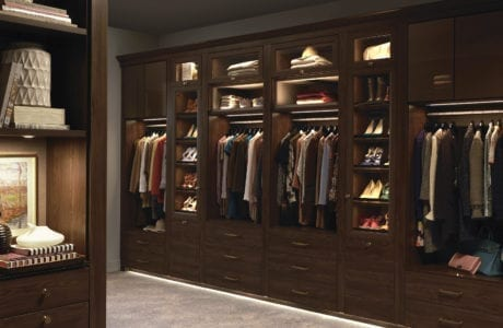 Dark Wood Walk in Closet with Cabinets Closet Rods Dresser Drawers and Display Shelving