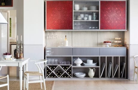 Grey pantry design with shelving wine display and red accent cabinets Northern New Jersey
