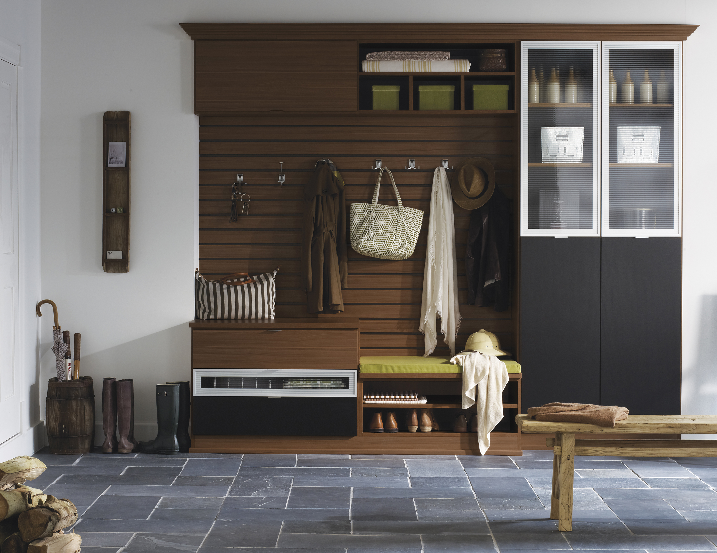 Dark Wood Entrance Way Storage with Shelving Coat Hoots Bench Seating and Accent Cabinet Doors in Both Black and Frosted Glass With White Trim