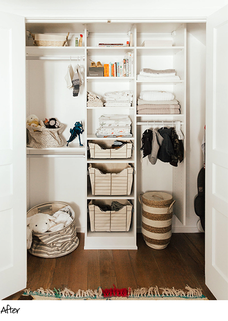 Organized reach in closet with cream colored shelving