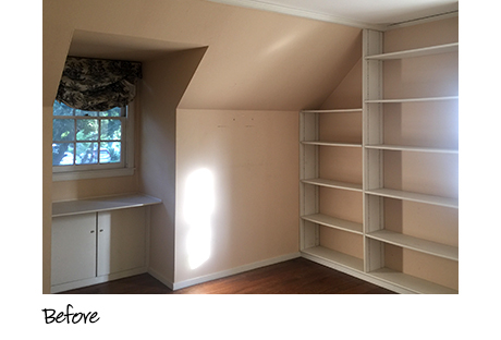 Empty cream colored closet with shelving before installation