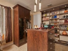 Walk in closet with wood finish and center island for client Danielle S.