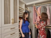 California Closets client Jenny Lee and her designer using pull out tie racks