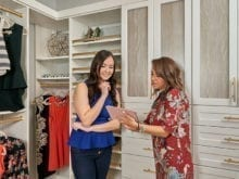 California Closets client Jenny Lee and her designer consulting on designs on an Ipad