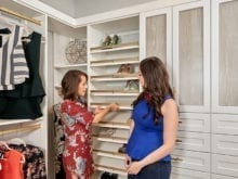 Client Jenny Lee and her designer admiring the shoe shelves in her new closet