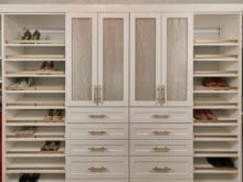 Tan and gold wardrobe with slanted shoe shelves in California Closets client Jenny Lee's new closet