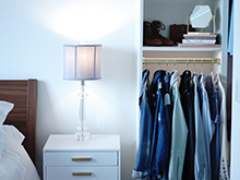 California Closets Client Story Becky Kung Velvet and Vino Client Bedside Table and Jackets