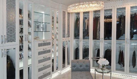 California Closets Michelle Mangini Client Story white glass cabinets clothing