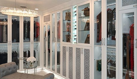 California Closets Michelle Mangini Client Story white glass cabinets bags and clothing