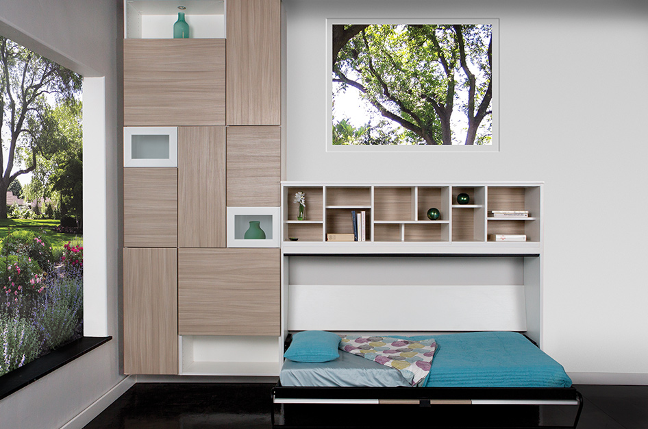 Pulled out Murphy bed with shelving space above and modern cabinetry to the side.