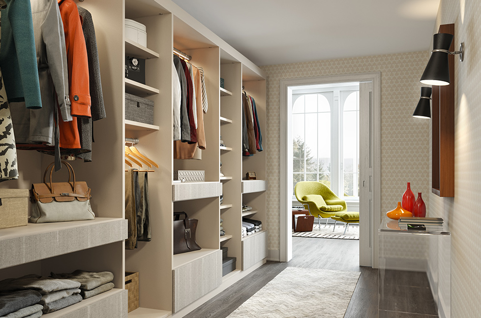 Walk through closet with shelving space for towels, coats, shoes and more.