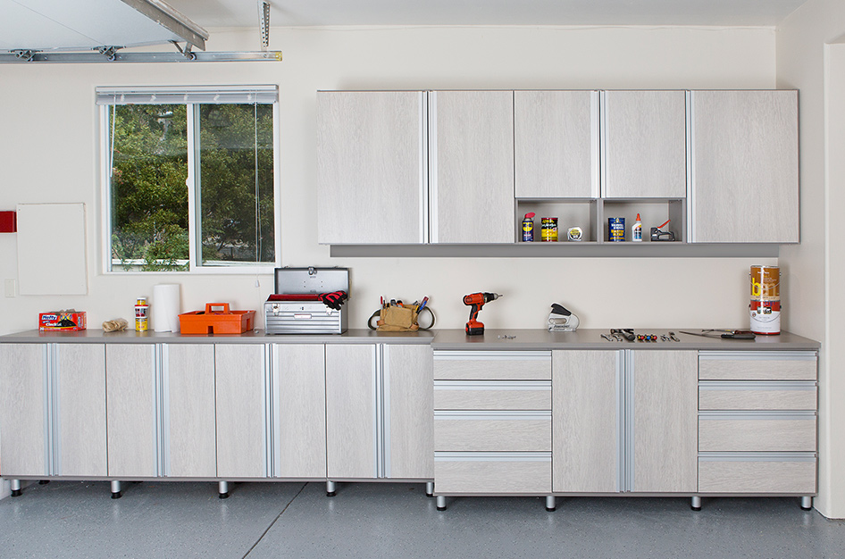 Garage furnished with cabinetry, drawers and shelves.