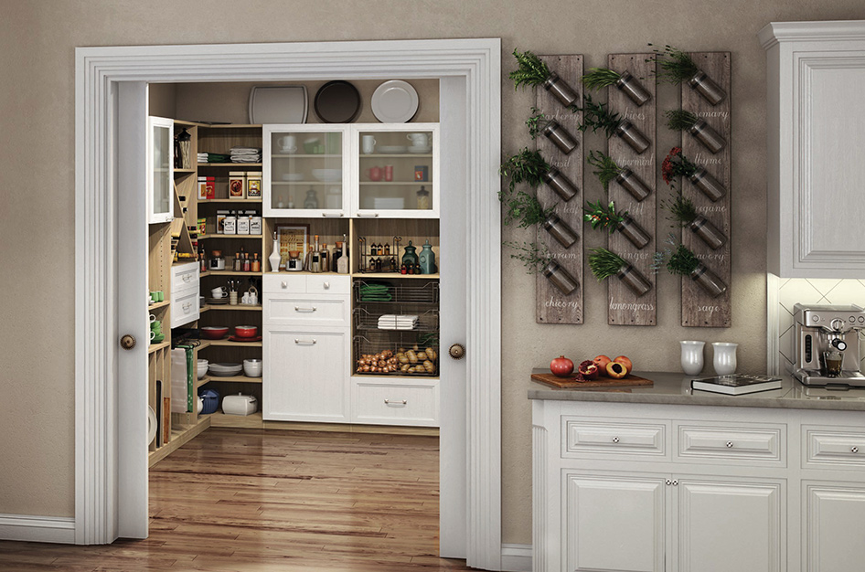 Walk-in pantry showcasing the organization of of the custom shelving.