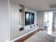 Tara Blanchet Client Story Classic White Finish Media Center with glass paneling and Recessed Accent Lighting