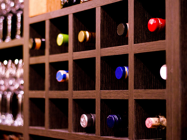 California Closets New Orleans - Custom Wine Bar Storage Cubbies