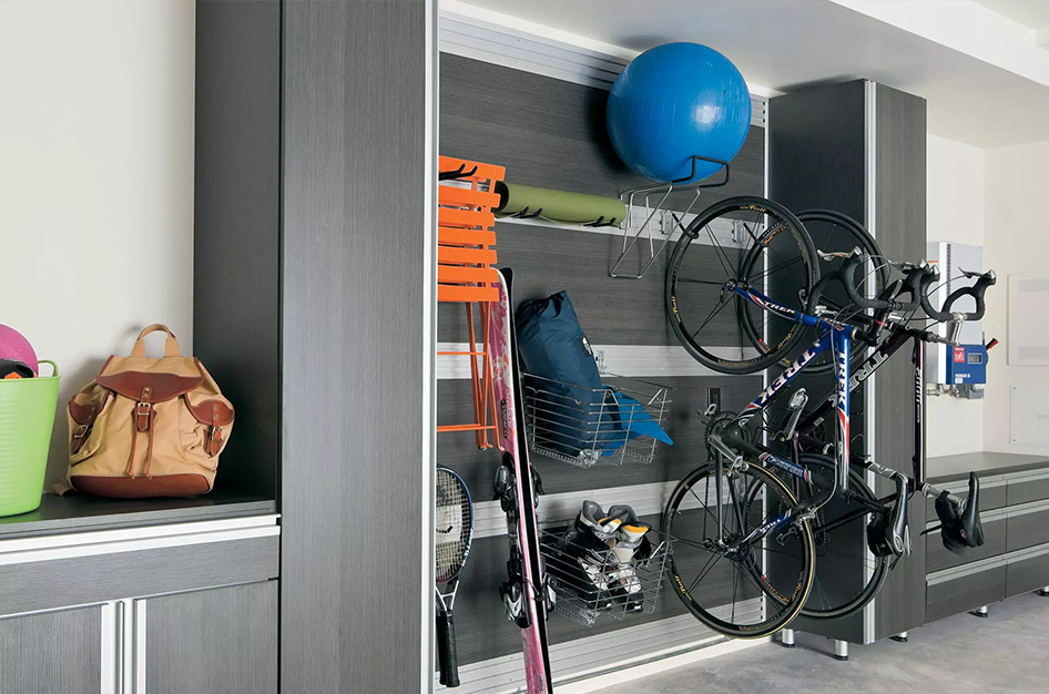 Garage cabinetry with racks for hanging bikes, snowboards, and other outdoor equipment.