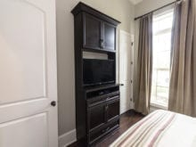 Melissa Maeker Commercial Client Story California Closets Bedroom Storage Solution in Dark Brown Finish