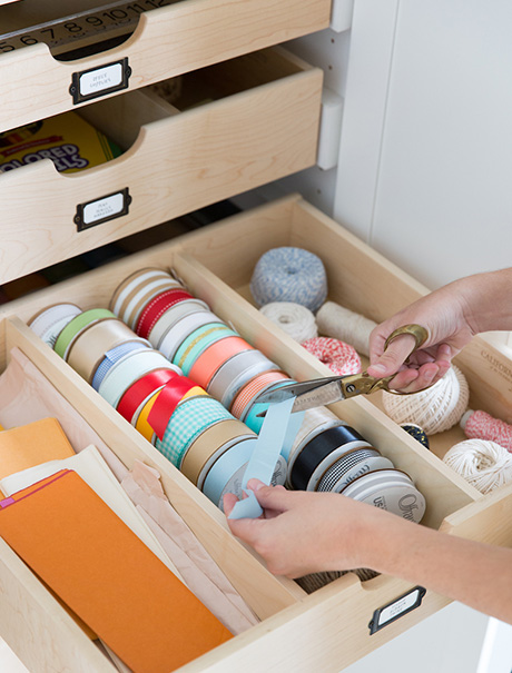 Camille Styles Craft Room Client Story California Closets Austin Cutting Decorative Ribbons