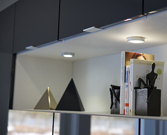 Alisha Close up detail image of accent lighting in white recessed cabinet space
