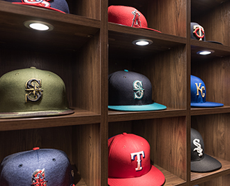 Close up of MLB hat storage in lighted cubby closet system