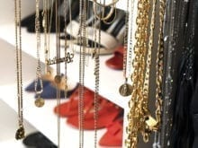 Client Stories Lana Alicia Close Up of Hanging Gold Jewelry
