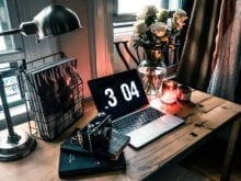 Luanna Perez Garreaud Steampunk Desk Space with Candle Light and Rustic Furniture