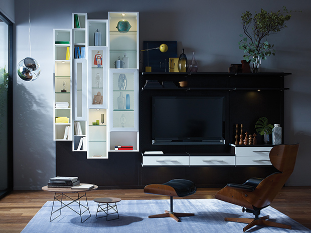 Black Entertainment Center with White Shelves and Accent Drawers and Glass Fronted Display Cabinets