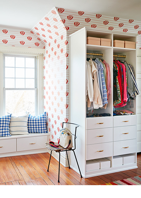Clare Vivier Classic White Closet Space with Brass Hardware and Colorful Wallpaper